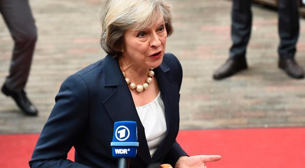 Britain's Prime minister Theresa May addresses journalists as she arrives for an European Union leaders summit on October 20, 2016 at the European Council, in Brussels. AFP/Getty Images