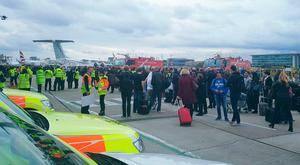 Handout photo taken with permission from the Twitter feed of Shauna/@shaunaaa of passengers outside the terminal building and grounded flights at London City Airport following an alert. PA