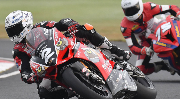 Family fortunes: Glenn Irwin (top) on the Be Wiser Ducati set the pace in the Superbikes