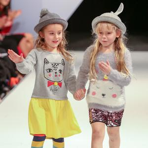 West Coast Cooler Fashion Week. Pictured: Valentina with a Grey and Yellow Jumper Dress and PomPom Hat and Lucy with Sequin Shorts, a Grey Bear Jumper and Bunny Hat from M&S. Picture: Philip Magowan / PressEye (21st October 2016)
