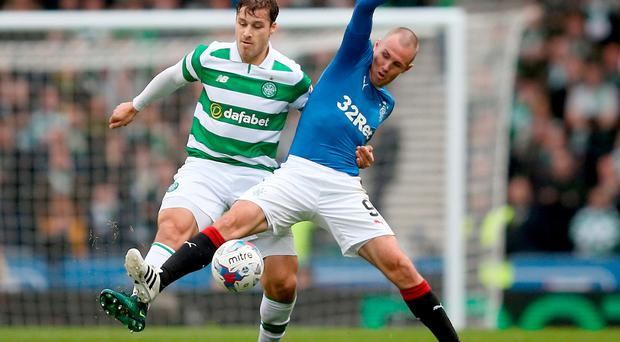 Celtic's Tom Rogic (left) and Rangers' Kenny Miller in action during the Betfred Cup, Semi Final match at Hampden Park, Glasgow. PRESS ASSOCIATION Photo. Picture date: Sunday October 23, 2016. See PA story SOCCER Rangers. Photo credit should read: Jane Barlow/PA Wire. EDITORIAL USE ONLY
