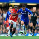 Manchester United's Eric Bailly (left) and Chelsea's Diego Costa battle for the ball during the Premier League match at Stamford Bridge, London. PRESS ASSOCIATION Photo. Picture date: Sunday October 23, 2016. See PA story SOCCER Chelsea. Photo credit should read: John Walton/PA Wire. RESTRICTIONS: EDITORIAL USE ONLY No use with unauthorised audio, video, data, fixture lists, club/league logos or