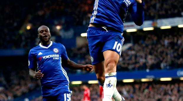 Chelsea's Eden Hazard celebrate scoring his side's third goal of the game during the Premier League match at Stamford Bridge, London. PRESS ASSOCIATION Photo. Picture date: Sunday October 23, 2016. See PA story SOCCER Chelsea. Photo credit should read: Nick Potts/PA Wire. RESTRICTIONS: EDITORIAL USE ONLY No use with unauthorised audio, video, data, fixture lists, club/league logos or