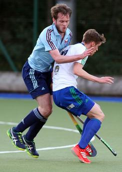Up close: Stephen McGrath (left) of Belfast Harlequins challenges Cork C of I's Alec Moffett at Deramore Park