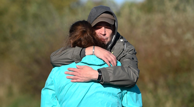 'Kamil's brother Marian Cervenka is consoled after visiting the scene of the tragic crash