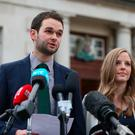 Daniel and Amy McArthur of Ashers Baking Company speak to the media at Belfast High Court, as judgment is due to be delivered on an appeal brought by the Christian bakers who were found to have discriminated against gay man Gareth Lee. Photo: Niall Carson/PA Wire