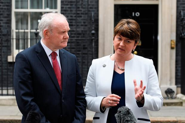 Deputy First Minister of Northern Ireland Martin McGuinness (L) and First Minister of Northern Ireland Arlene Foster speak to journalists (Photo by Leon Neal/Getty Images)