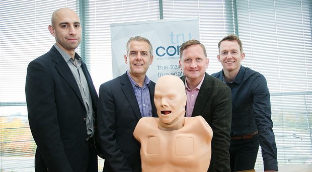 Michael Calo, Stephen McClelland, Mike Irvine and Ryan Colhoun celebrate the acquisition of TruCorp, which was formed in 2002