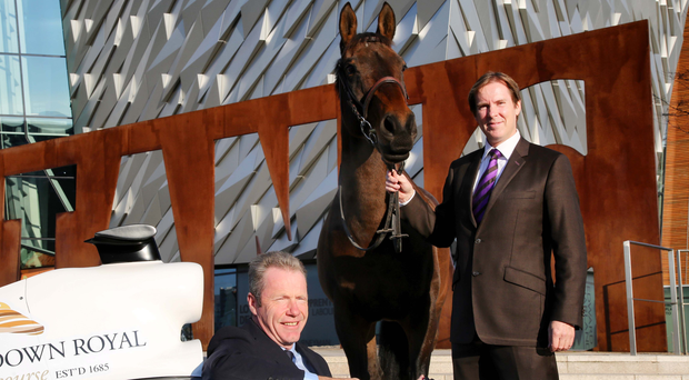 Driving seat: Grand National winning jockey turned broadcaster Mick Fitzgerald (seated) and Down Royal General Manager Mike Todd at Festival launch at Titanic Centre