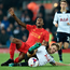 Pain: Liverpool's Georginio Wijnaldum is challenged by Tottenham's Eric Dier