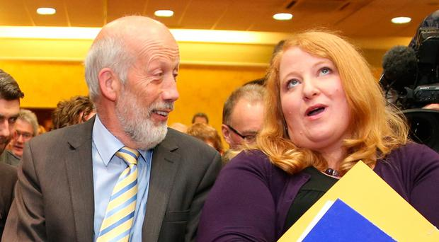 Alliance Party's outgoing leader David Ford sits alongside deputy leader Naomi Long who is set to be elected as the new leader of the party at a special meeting of the party council in the Park Avenue Hotel, Belfast.