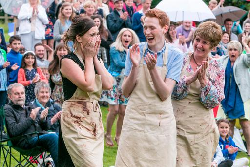 Jane Beedle (right), Andrew Smyth and Candice Brown, who has been crowned champion of this year's Great British Bake Off. PA