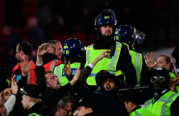 Riot police are deployed to deal with fans clashing during the EFL Cup fourth round match between West Ham United and Chelsea at The London Stadium on October 26, 2016 in London, England. (Photo by Dan Mullan/Getty Images)