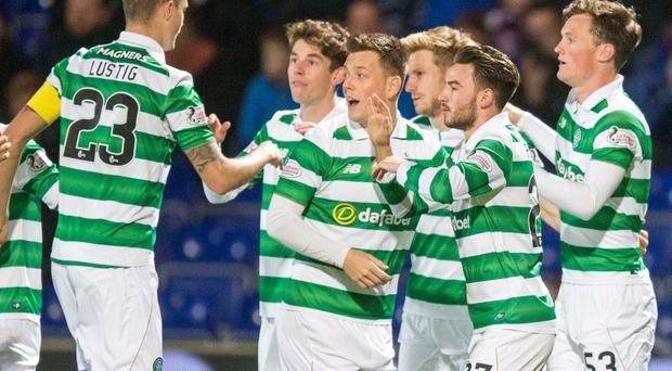 Celtic's Patrick Roberts (no. 27) celebrates scoring his side's first goal of the game with team-mates during the Ladbrokes Scottish Premiership match at the Global Energy Stadium, Dingwall. PA