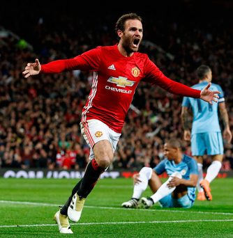 Breakthrough: Juan Mata roars with delight after finding the net