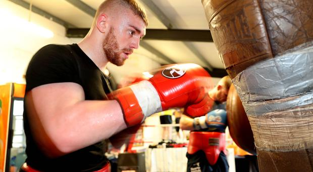 Glove affair: Lewis Crocker prepares at Breen's Gym in Belfast for his professional debut at the Titanic Exhibition Centre on November 5