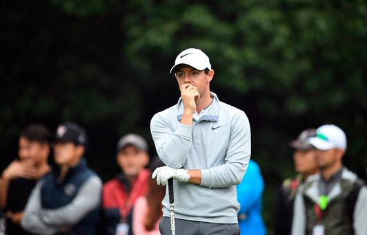 Pensive: Rory McIlroy at the Champions event in Shanghai