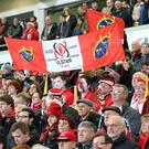 United in grief: Ulster fans pay tribute to the late Anthony Foley by holding up a message alongside Ulster and Munster flags during the clash with Exeter