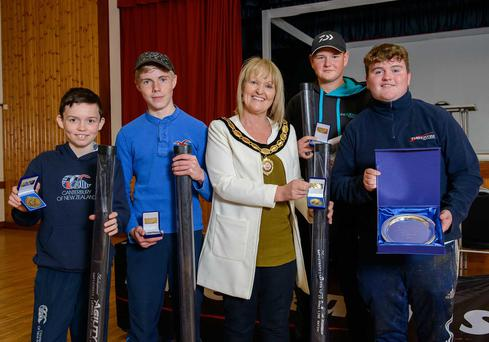 Catching them young: Schools angling champions, Erne Integrated, receive their prizes from Sharon McAleer, vice chair of Mid Ulster District Council