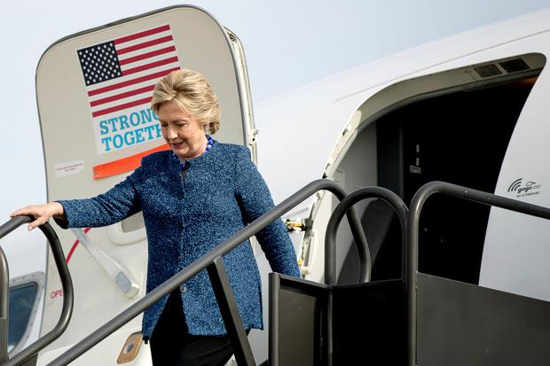 Democratic presidential candidate Hillary Clinton arrives at Eastern Iowa Airport in Cedar Rapids, Iowa, Friday, Oct. 28, 2016, to attend a rally. (AP Photo/Andrew Harnik)