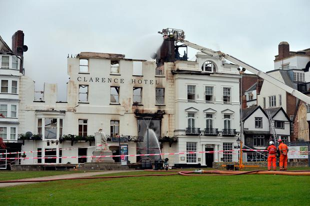 Firefighters continue to tackle the blaze in Exeter which has badly damaged The Royal Clarence Hotel, the