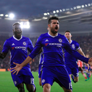 Main man: Diego Costa leads the Chelsea celebrations after putting his side 2-0 up at Southampton