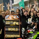 Hands up: Jonathan Rea and Kawasaki celebrate retaining the World crown