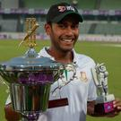 Bangladesh's Mehedi Hasan poses for a photograph with the 'Man of the Series' award