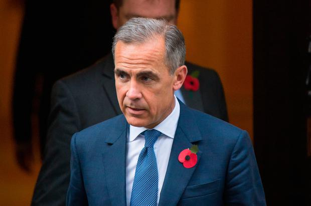 Bank of England governor Mark Carney is extending his term by another year