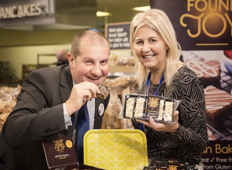 Rodney Cupples of Tesco NI with Carol Little, owner of New Found Joy