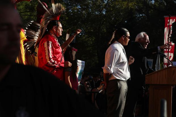 US Sen. Bernie Sanders (I-VT) (R) speaks during a rally against the Dakota Access Pipeline September 13, 2016 at Lafayette Square in Washington, DC. Activists held a rally calling on President Barack Obama to stop the Dakota Access Pipeline. (Photo by Alex Wong/Getty Images)