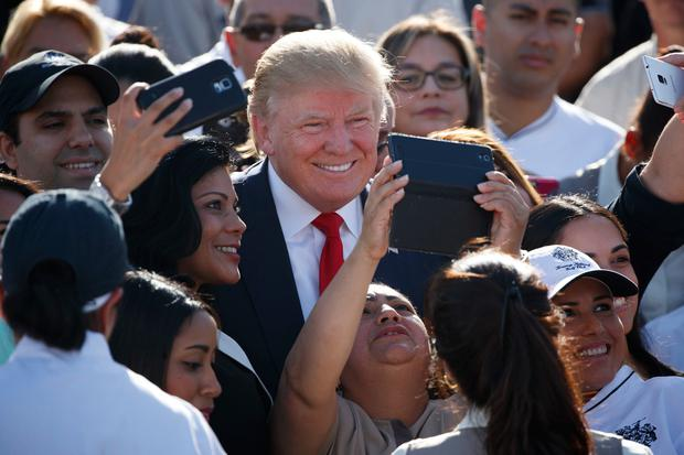 Republican presidential candidate Donald Trump poses for photographs during an campaign event at Trump National Doral, Tuesday, Oct. 25, 2016, in Miami. (AP Photo/ Evan Vucci)