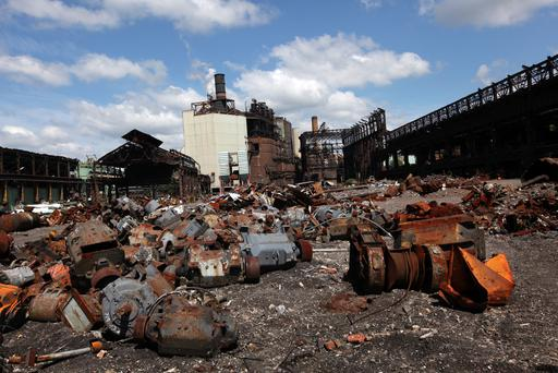 Scrap used to make steel lies on the ground outside the idled ArcelorMittal Weirton Steel Plant in Weirton, West Virginia. Although the steel plant in Weirton has been idled for over two years, local steel workers still hold out hope that it will eventually start back up. (Photo by Rick Gershon/Getty Images)