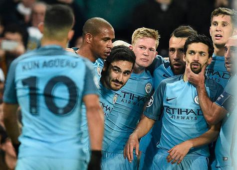 Manchester City's German midfielder Ilkay Gundogan (3L) celebrates scoring his team's third goal during the UEFA Champions League group C football match between Manchester City and Barcelona at the Etihad Stadium in Manchester, north west England on November 1, 2016. AFP/Getty Images