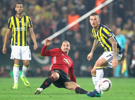ISTANBUL, TURKEY - NOVEMBER 03: Zlatan Ibrahimovic of Manchester United and Alper Potuk of Fenerbahce in action during the UEFA Europa League Group A match between Fenerbahce SK and Manchester United FC at Sukru Saracoglu Stadium on November 3, 2016 in Istanbul, Turkey. (Photo by Chris McGrath/Getty Images)