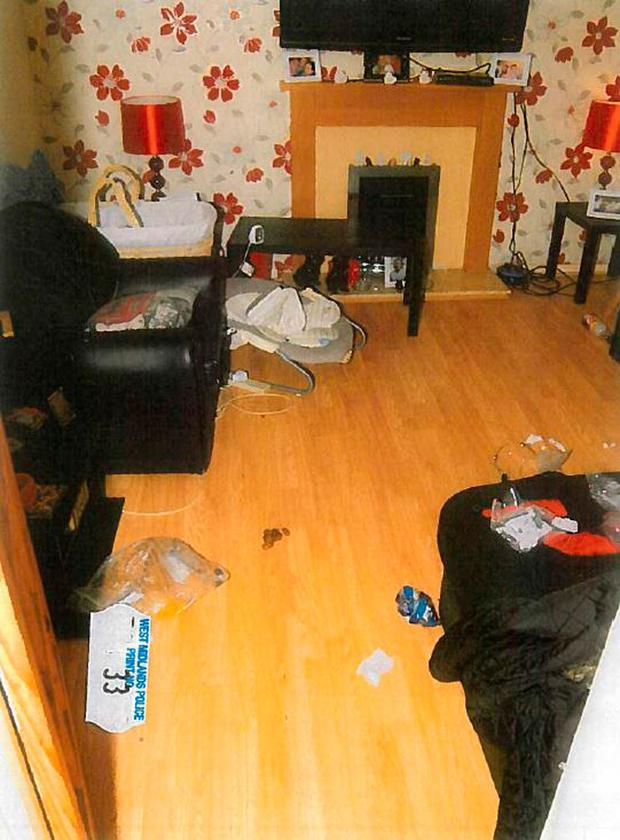 Photo issued by West Midlands Police of the living room at Whitburn Close, Wolverhampton where Daniel Sanzone murdered his 13-day-old son Joshua Millinson by shaking him to death. PA