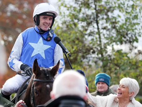 Good to talk: Ruby Walsh chats to broadcaster Pamela Ballantine after winning on Airlie Beach, the second leg of a treble for the top jockey, at the Down Royal Festival yesterday