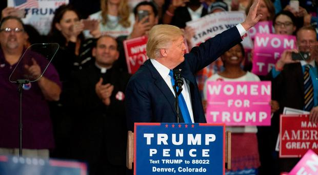 Republican presidential nominee Donald Trump waves to supporters before his speech at the National Western Complex in Denver, Colorado on November 5, 2016. White House Republican candidate Donald Trump was earlier in the day bundled off stage by security officers on November 5 after a false gun scare during a campaign appearance. / AFP PHOTO / Jason ConnollyJASON CONNOLLY/AFP/Getty Images