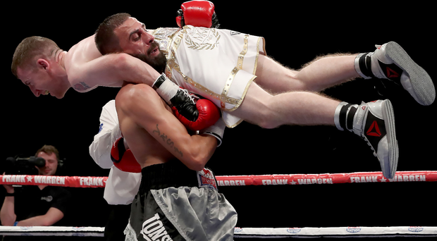 Lift off: Paddy Barnes defeats Stefan Slavchev after the Bulgarian was disqualified for lifting him during the Flyweight Contest at the Titanic Exhibition Centre