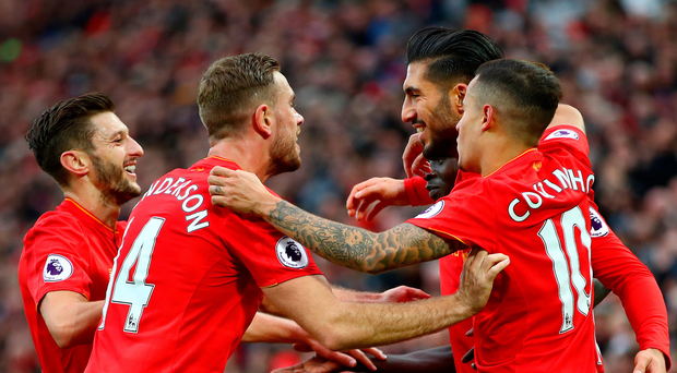 Can do: Team-mates congratulate Emre Can after he scored Liverpool's third against Watford