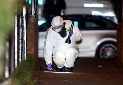 Police at the scene of a shooting in the Springview Walk area of west Belfast