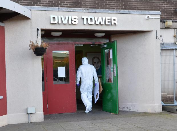 Forensics at the scene at Divis Tower in west Belfast. Pic Colm Lenaghan/Pacemaker
