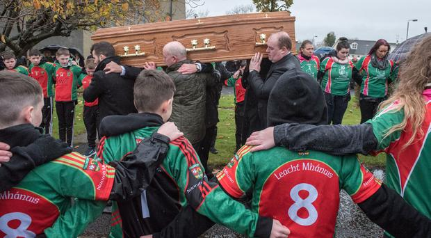 The funeral of 22-year-old Kevin King who died suddenly as he played indoor football. He also played for St Mary's GAC, Slaughtmanus. Picture Martin McKeown. Inpresspics.com. 08.11.16