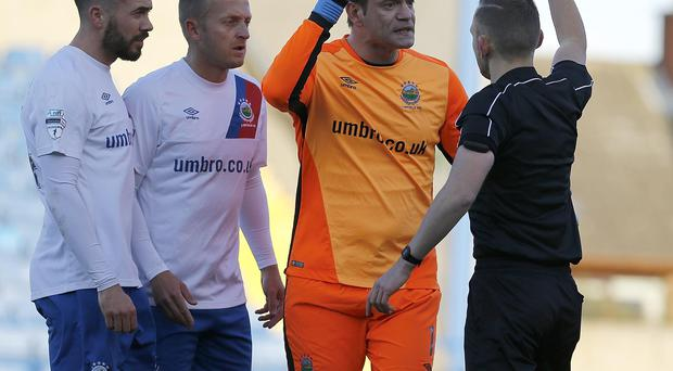 Wrong: Roy Carroll's red card was embarrassing for officials