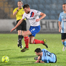 On his way: Linfield ace Stephen Lowry skips past Willie Faulkner at the Showgrounds