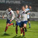 Goal crazy: Linfield's Mark Haughey after scoring at Ballymena