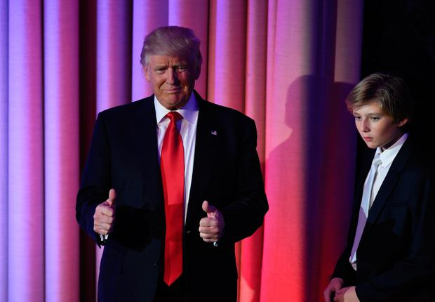 TOPSHOT - US President-elect Donald Trump arrives with his son Baron at the New York Hilton Midtown in New York on November 8, 2016. Trump stunned America and the world Wednesday, riding a wave of populist resentment to defeat Hillary Clinton in the race to become the 45th president of the United States. / AFP PHOTO / SAUL LOEBSAUL LOEB/AFP/Getty Images