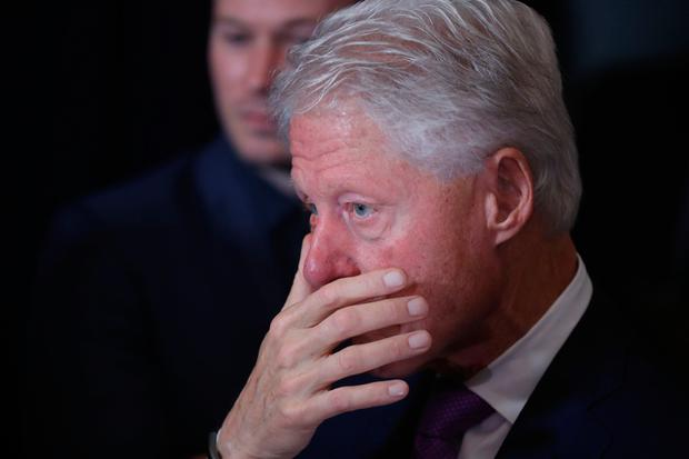 Former President Bill Clinton listens as his wife, Democratic presidential candidate Hillary Clinton speaks in New York, Wednesday, Nov. 9, 2016. Clinton conceded the presidency to Donald Trump in a phone call early Wednesday morning, a stunning end to a campaign that appeared poised right up until Election Day to make her the first woman elected U.S. president. (AP Photo/Andrew Harnik)