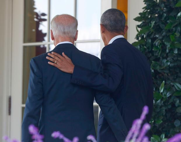 President Barack Obama, accompanied by Vice President Joe Biden, walks back into the Oval Office of the White House in Washington, Wednesday, Nov. 9, 2016, after speaking about the election in the Rose Garden. (AP Photo/Pablo Martinez Monsivais