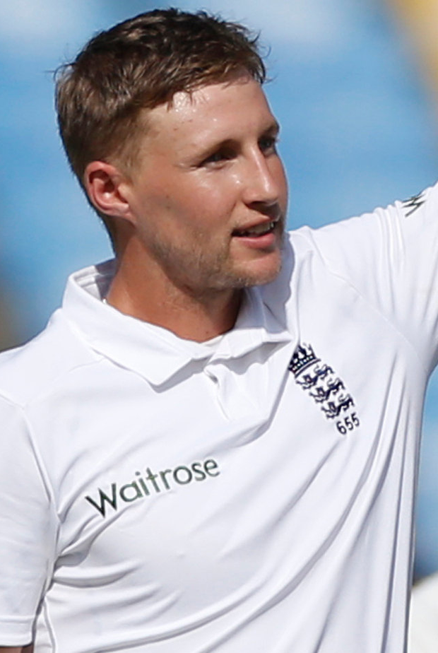 Top form: Joe Root reaches his century on the way to 124
